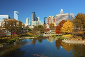 Charlotte skyline, park, and autumn trees